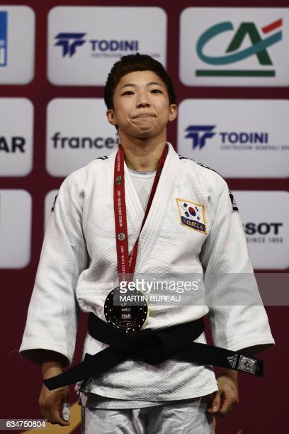 Korean Bokyeong Jeong stands on the first place of the podium of the 48 kgs on February 11 2017 at the Accord Hotels Arena in Paris during the Judo...