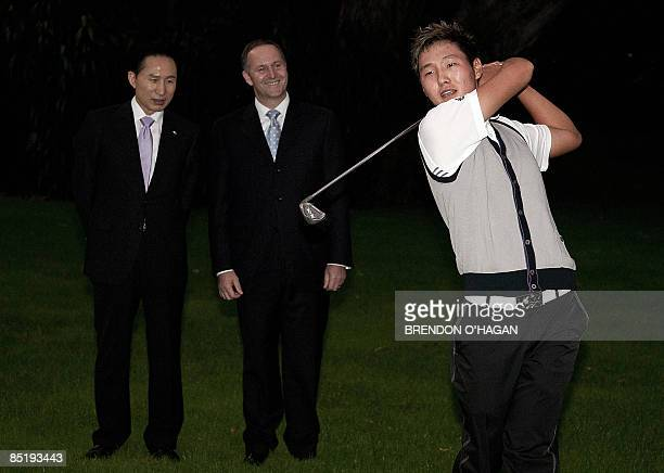 Korean born and now New Zealand citizen golf player Danny Lee demonstrates his swing as Rebublic of Korea President Lee Myungbak and New Zealand...