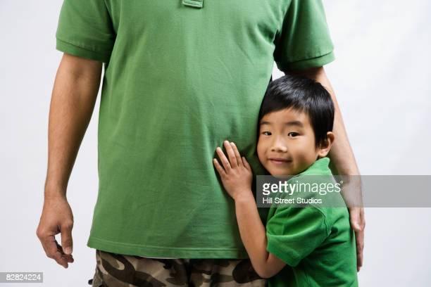 Korean boy hugging father