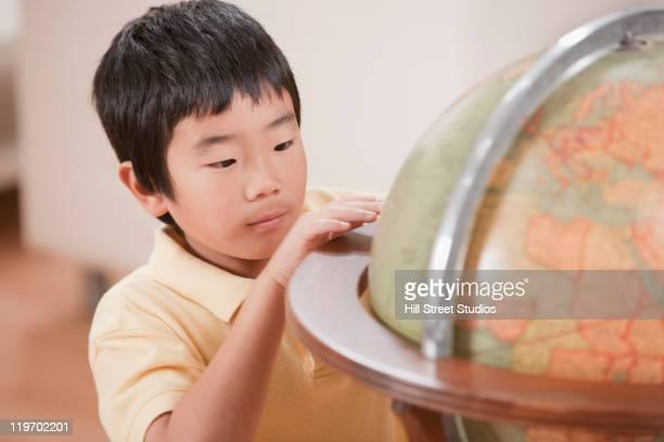 korean boy looking at globe - gardena california stock pictures, royalty-free photos & images