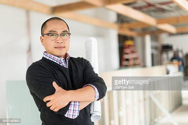 Korean businessman standing with arms crossed