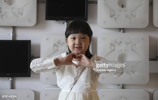 Korean child actress Kim Seol a player from the Turkish Movie 'Ayla' poses during an exclusive interview with the Turkish semiofficial news Agency...