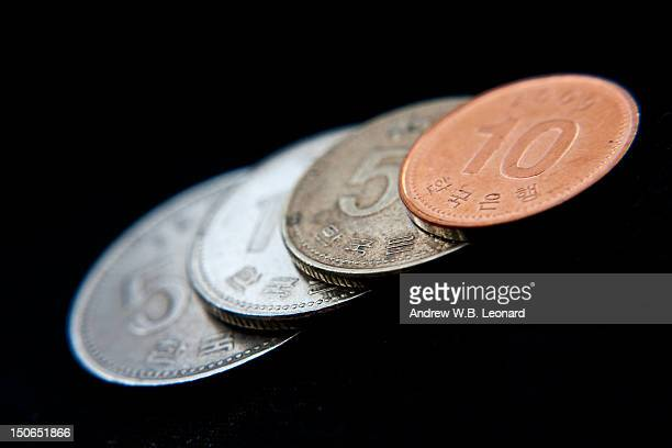korean coinage - korean currency stock photos and pictures