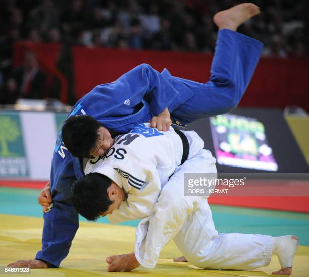 Korean DaeNam Song battles with Korean JaeBum Kim on February 8 during their men final round in the 81 kg category at the Paris judo tournament part...
