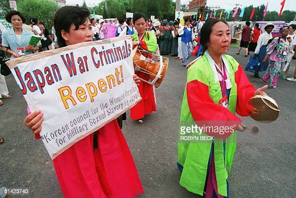 Korean delegates protest against what they consider Japan's inadaquate responese to the use of Koreans and other women as comfort women in World War...