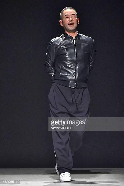 Korean designer Juun J walks the runway during the JuunJ Menswear Fall/Winter 20152016 show at Palais de Tokyo as part of the Paris Fashion Week on...