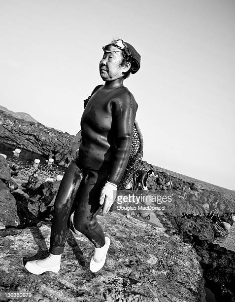Korean diving woman carries her nets home in southern Jeju Island, South Korea.