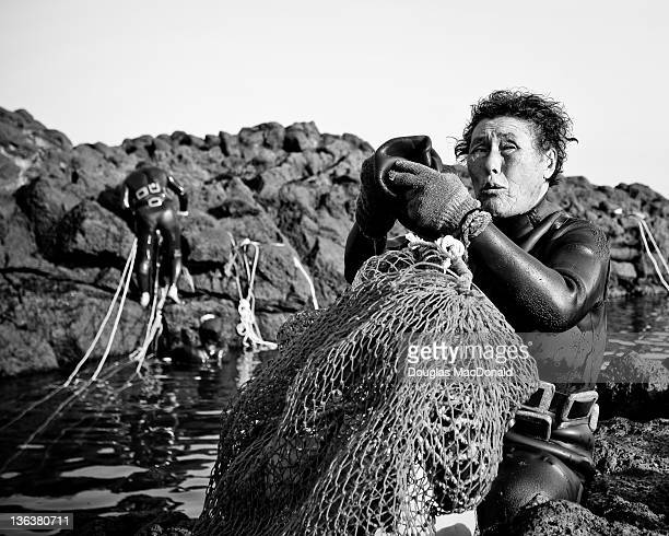 A Korean diving woman takes a break in southern Jeju Island South Korea