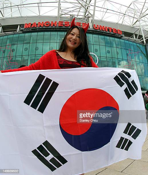 Korean fan enjoys the atmosphere outside the stadium prior to the Men's Football Semi Final match between Korea and Brazil on Day 11 of the London...