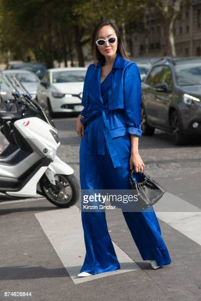 Korean fashion influencer Chriselle Lim wears an Acler coat and trousers The Row bag Celine shoes and Roberi Fraud sunglasses day 4 of Paris Womens...
