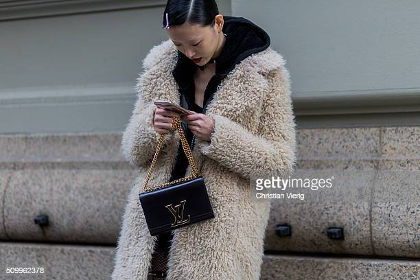 Korean fashion model Sora Choi wearing a beige fluffy fur jacket and a black Louis Vuitton bag seen outside Creatures of the Wind during New York...