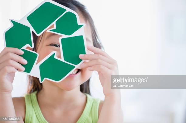 Korean girl holding recycle symbol