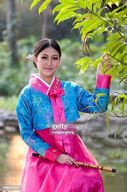 korean girl - bamboo flute stock-fotos und bilder