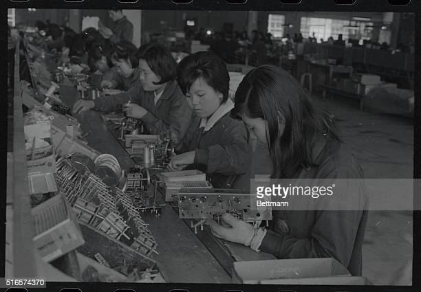 Korean girls in a Pusan plant complete radiosmany of which will be sent to Viet Nam