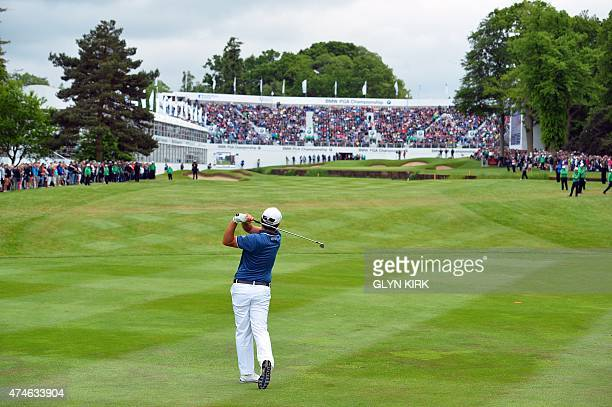 Korean golfer Byeong Hun An watches his approach shot to the 18th green on his way to winning the PGA Championship at Wentworth Golf Club in Surrey...