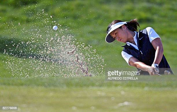 Korean golfer Grace Park hits a ball out of a bunker on the 12th hole during the first round of the LPGA Tour Mexican Open at the Bosque Real Golf...