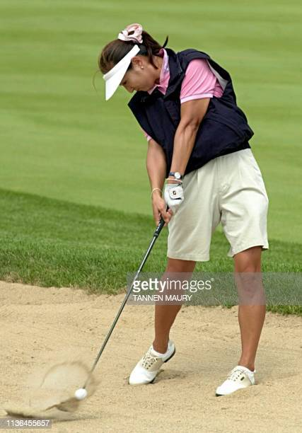 Korean golfer Grace Park hits out of the sand on the 17th fairway during final practice for the US Women's Open Championship 19 July 2000 in Gurnee...