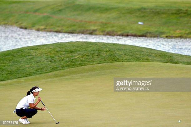 Korean golfer Grace Park studies her putt on the 9th hole during the first round of the LPGA Tour Mexican Open at the Bosque Real Golf Club in...