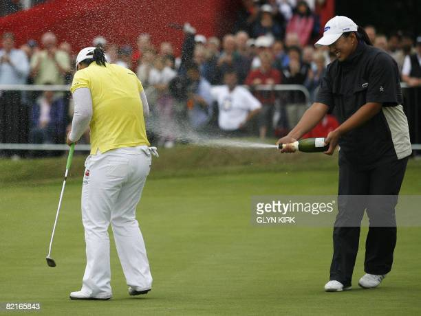 Korean golfer JiYai Shin is sprayed with champagne by compatriot Amy Yang on the 18th green after winning a final round of the Ricoh Women's British...