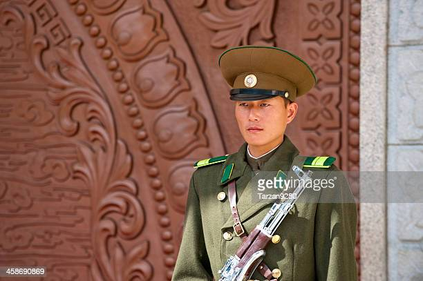 Korean guard standing in fornt of office building
