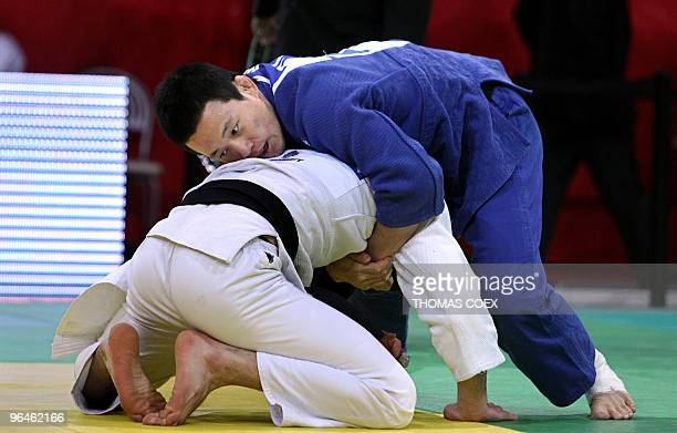 Korean KiChun Wang battles with Georgian Nugzar Tatalashvili during their men qualifying round fight in the under 73kg category as part of the Paris...