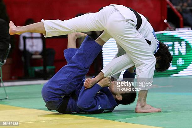 Korean KiChun Wang competes against Georgian Nugzar Tatalashvili during their men qualifying round fight in the under 73kg category as part of the...