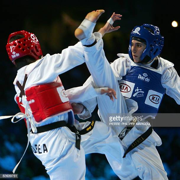 Korean Kim BoHye avoids a high kick of Turkish Zeynep Murat during their women's under 55 kg final match at the Taekwondo World Championships in...