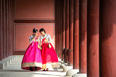 Korean lady in Hanbok or Korea gress and walk in an ancient town