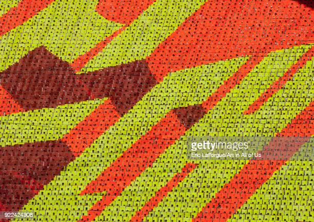 Korean letters made by children pixels holding up colored boards during Arirang mass games in may day stadium Pyongan Province Pyongyang North Korea...