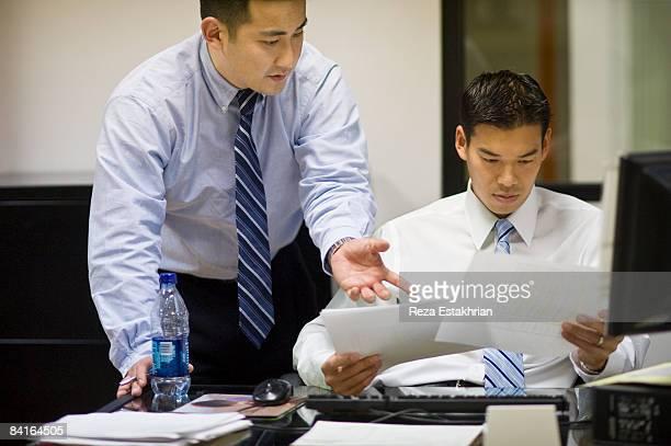 Korean man explains point on paperwork