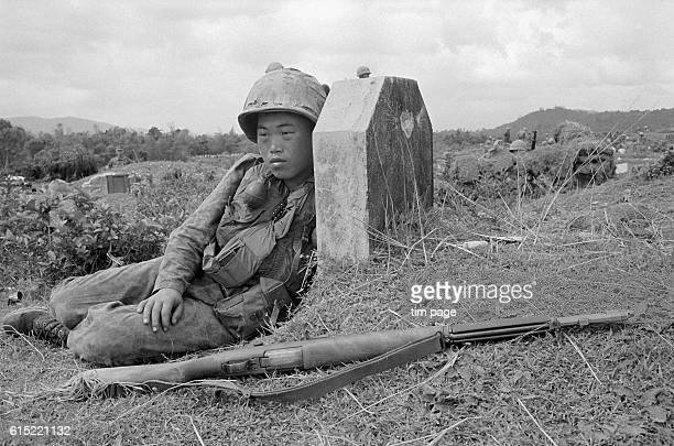 Korean marine rests against a stone after a night battle south of Quang Ngai. Vietnam, 1966.