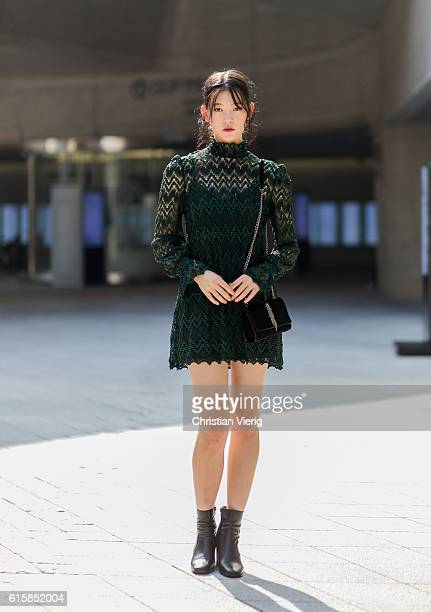 Korean model Cheongsol Jeong wearing a green sheer dress black bag and chelsea boots on October 20 2016 in Seoul South Korea