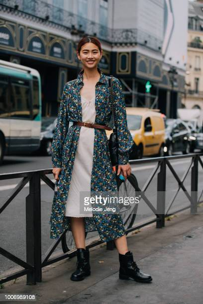Korean model Hoyeon Jung wears a a blue floral HM dressshirt pink slip dress leather belt black Chanel bag and black boots after the Schiaparelli...