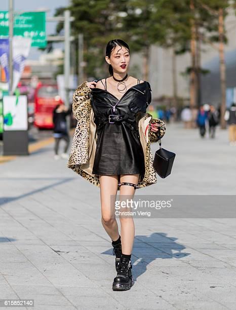 Korean model Sora Choi wearing a black leather jacket and leather dress leo animal print coat on October 20 2016 in Seoul South Korea