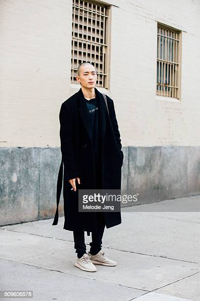 "Korean model Sung Jin Park wears a black jacket Cav Empt shirt and adidas YEEZY Boost 350 ""Oxford Tan"" shoes during New York Fashion Week Men's..."
