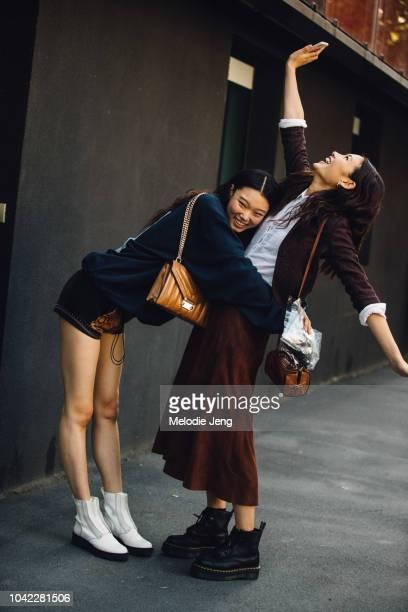 Korean models Yoon Young Bae Hoyeon Jung hug after Etro during Milan Fashion Week Spring/Summer 2019 on September 21 2018 in Milan Italy