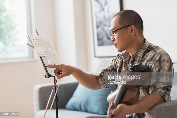 Korean musician using cell phone in living room