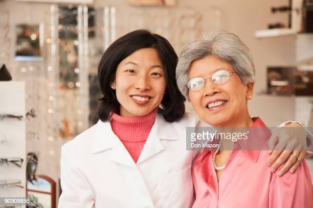 Korean optician standing with customer