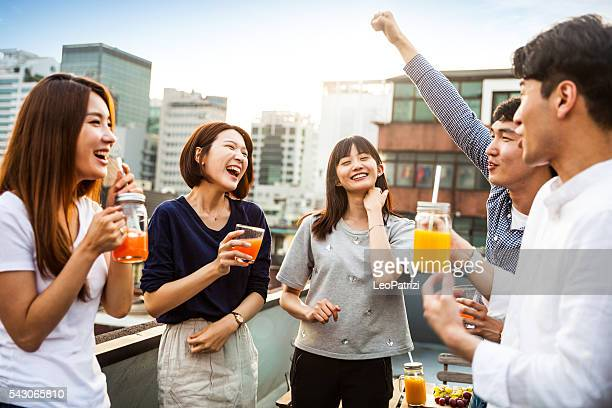 korean people having rooftop party in seoul - korean ethnicity stock pictures, royalty-free photos & images