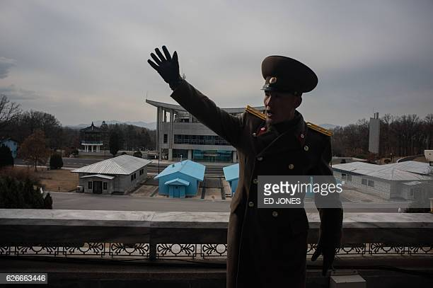 A Korean People's Army soldier gestures before the joint security area and Demilitarized Zone separating North and South Korea in Panmunjom near...