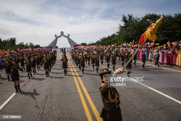 A Korean People's Army soldier leads a military band during an 'international march for peace prosperity and reunification of Korea' at the Three...