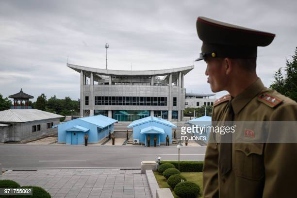 Korean People's Army soldier Lieutenant Colonel Hwang Myong Jin stands before the South Korean side of the truce village of Panmunjom on the North...