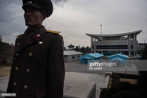A Korean People's Army soldier stands before the joint security area and Demilitarized Zone separating North and South Korea in Panmunjom near...