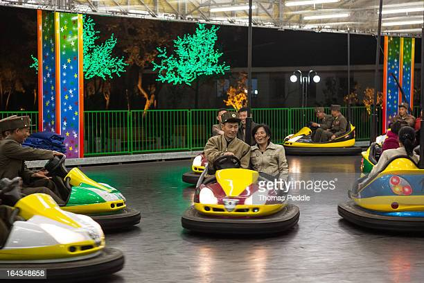 CONTENT] Korean People's Army soldiers enjoy themselves on a night out at Pyongyang's new funfair