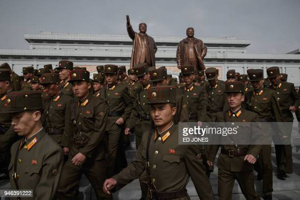 Korean People's Army soldiers leave after paying their respects before the statues of late North Korean leaders Kim Il Sung and Kim Jong Il at Mansu...