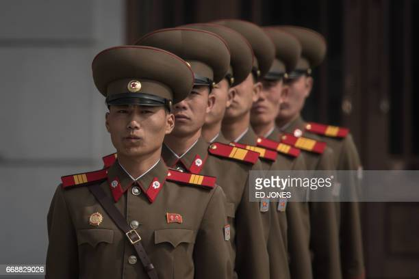 Korean People's Army soldiers line up to take their positions prior to a military parade marking the 105th anniversary of the birth of late North...