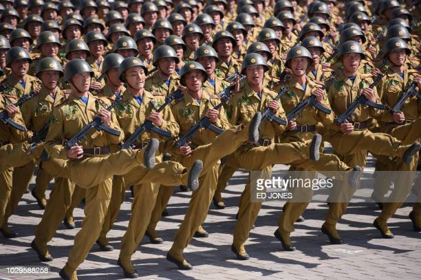 TOPSHOT Korean People's Army soldiers march during a mass rally on Kim Il Sung square in Pyongyang on September 9 2018 North Korea held a military...