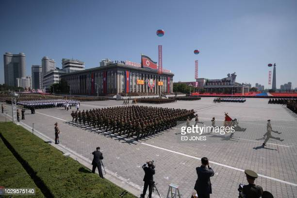 TOPSHOT Korean People's Army soldiers march during a military parade and mass rally on Kim Il Sung square in Pyongyang on September 9 2018 North...