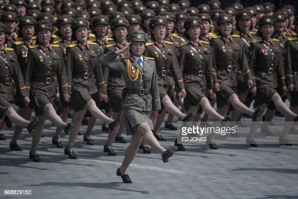 Korean People's Army soldiers march through Kim IlSung square during a military parade marking the 105th anniversary of the birth of late North...