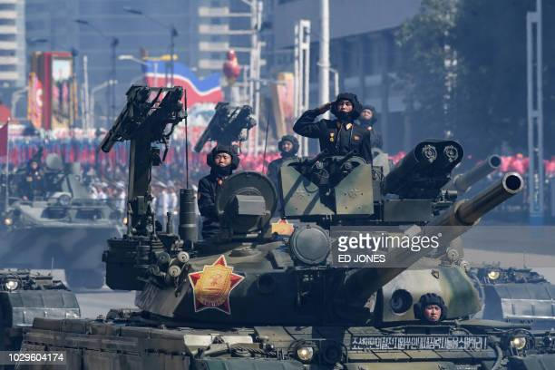 Korean People's Army soldiers stand atop armoured vehicles during a military parade on Kim Il Sung square in Pyongyang on September 9 2018 North...